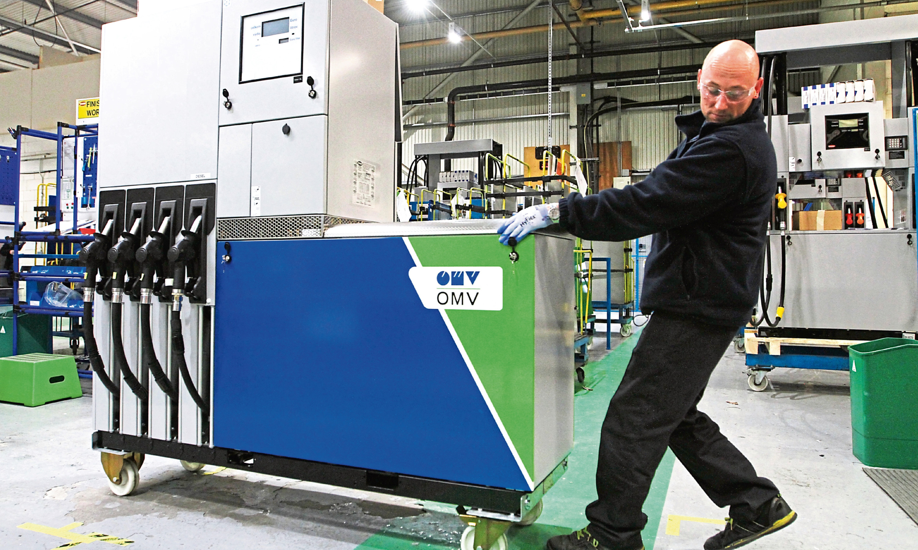 Lucas Krefe, an auditor in the finishing department wheels a Quantium 510 fuel dispenser across the floor of the Dundee factory