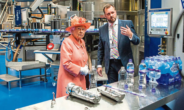 Courier News - Perth - Richard Burdge Story. The Queen visits Highland Spring factory, Blackford. Picture shows The Queen getting a demonstration from Bryan McCluskey (Group Operations Director). Highland Spring, Stirling Street, Blackford. Thursday 6th July 2017.