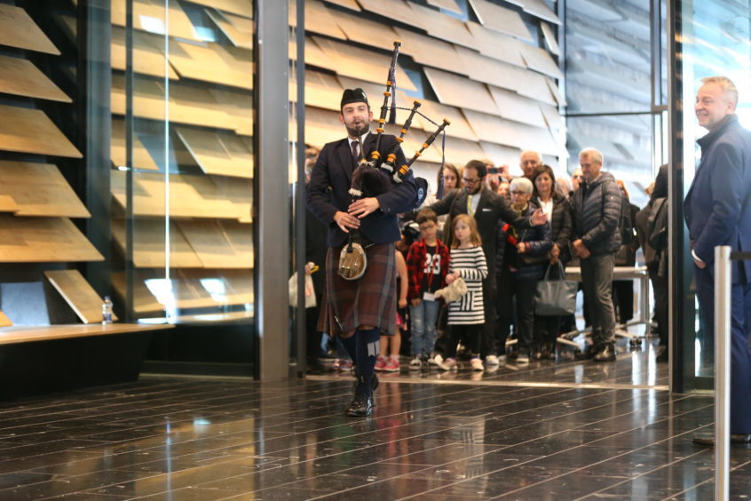 The first members of the public are piped into V&A Dundee.