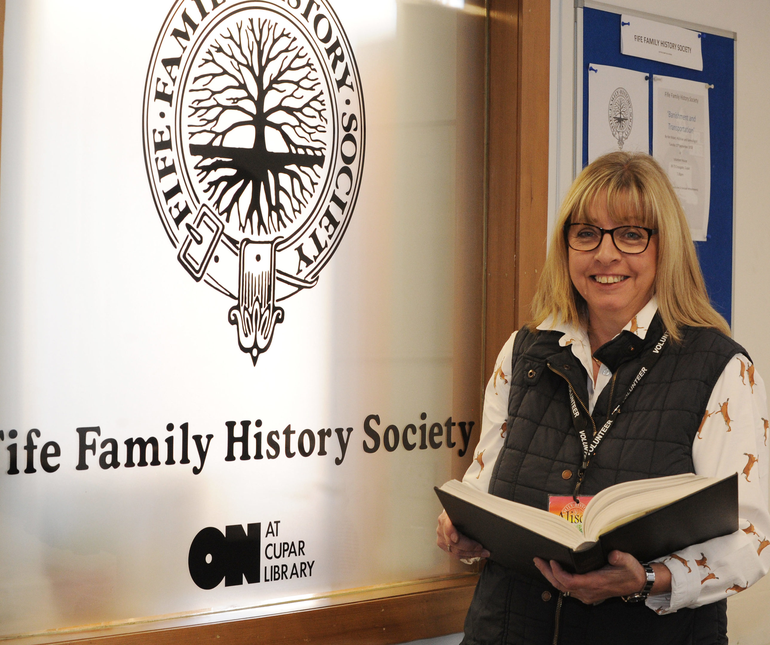 Fife Family History Society chairman Alison Murray and some of the resource material