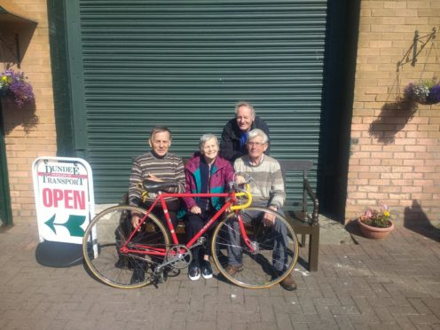Lil Stewart's bike was donated to Dundee Museum of Transport on Friday.  L-R Neil Hutchison, Lil Stewart, Charly Mathers, and Lionel Wylie