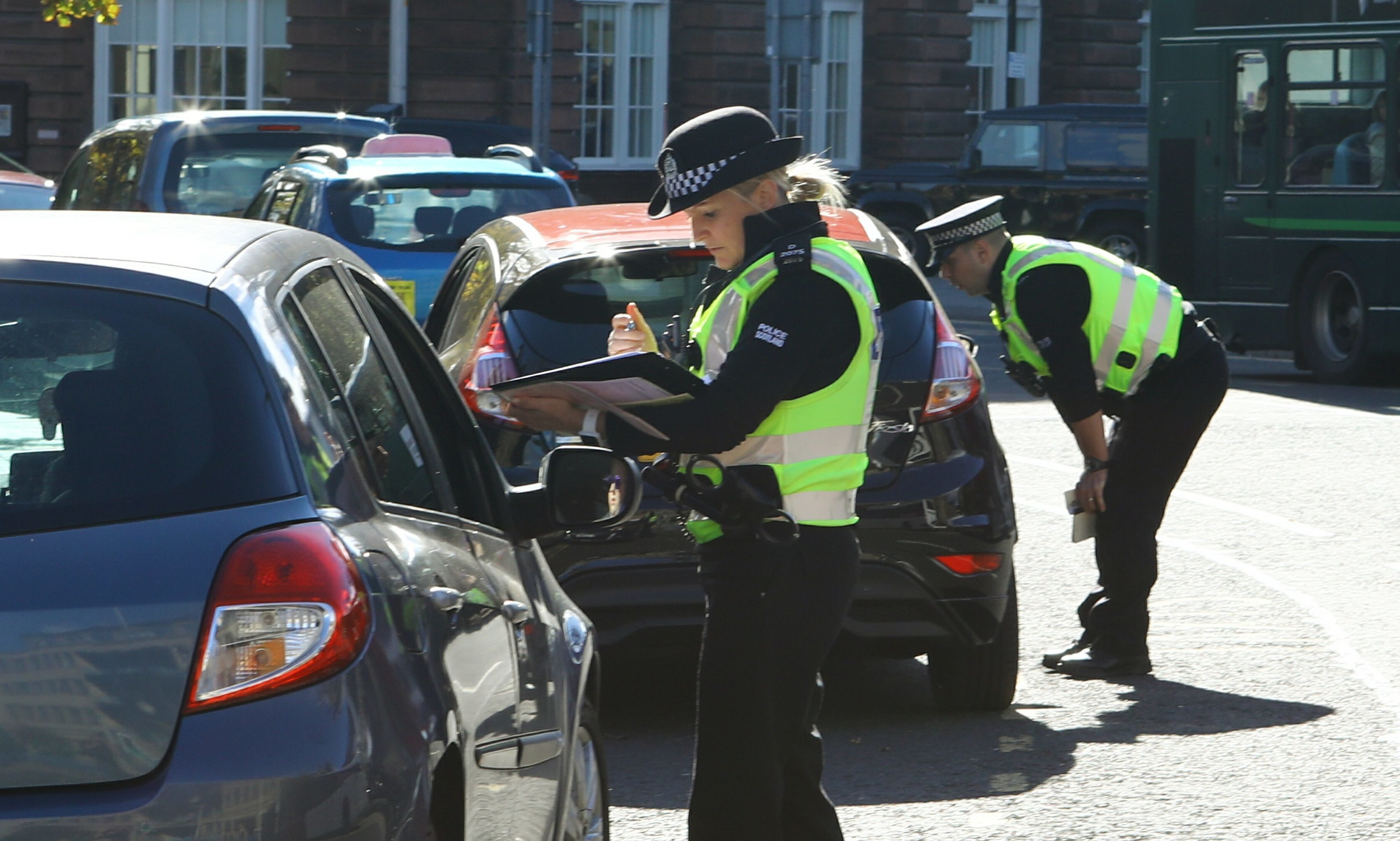 Police talking to motorists who were driving through Albert Square in Dundee on Monday