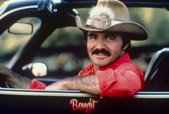 Burt Reynolds in the car from Smokey and the Bandit;