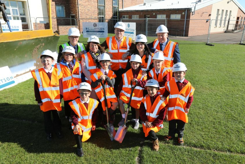 Youngsters were involved in the sod-cutting for the new shared campus.