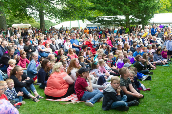 Huge crowds watching Mr Bloom and his Band on stage.