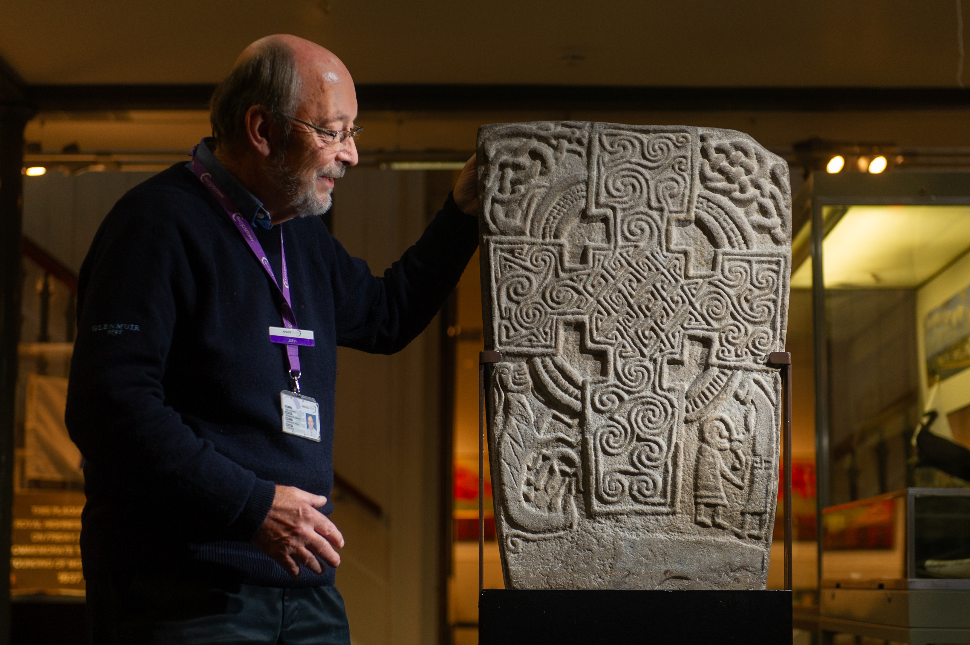 Angus Alive museums, galleries and archives collections officer John Johnston with the Inchbrayock Stone, Montrose Museum.
