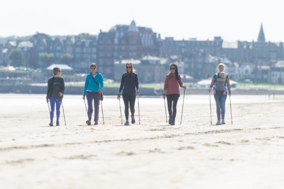 Nordic walking along the beach at West Sands. L-R Sam Mace (instructor), Helen Kermode, Claire McIntyre, Gayle and Cicely Threlfall and Isaac (10 mths).