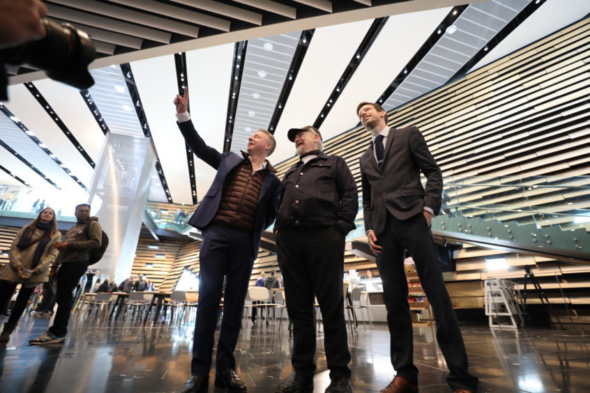 Phillip Long, Brian Cox and council leader John Alexander at the V&A Dundee