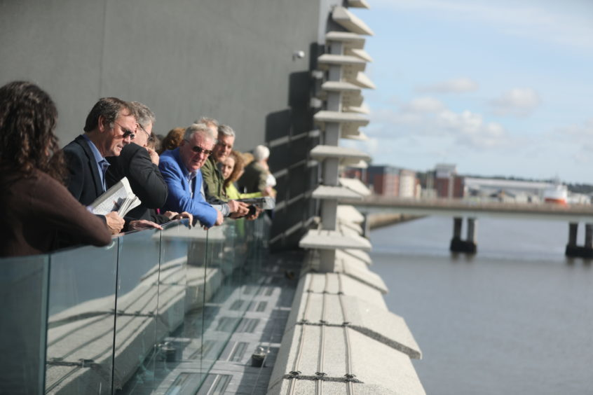 People enjoying the views of the Tay from the terrace.