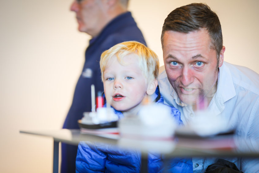Steve and Brodie Forster exploring the museum as the first members of the public enter the V&A on Saturday.