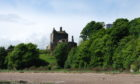 A view along the beach toward Ravenscraig Castle