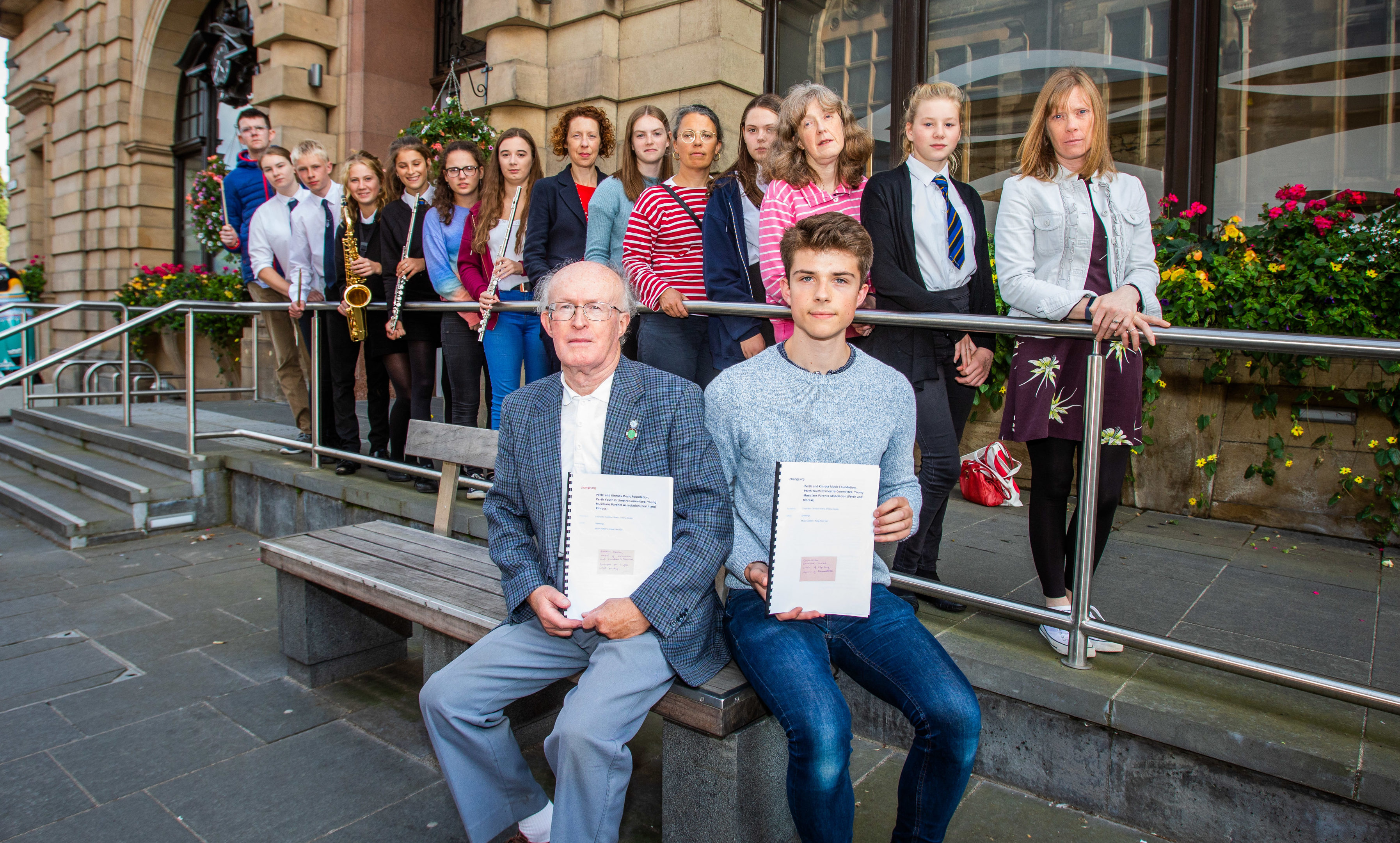 Protesting over tuition fees in 2018: At the front with the petitions are Alister Allan (left, first leader of Perth Youth Orchestra)  and Nicholas Baughan (right, current leader of Perth Youth Orchestra).