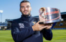 Tony Watt with his award.