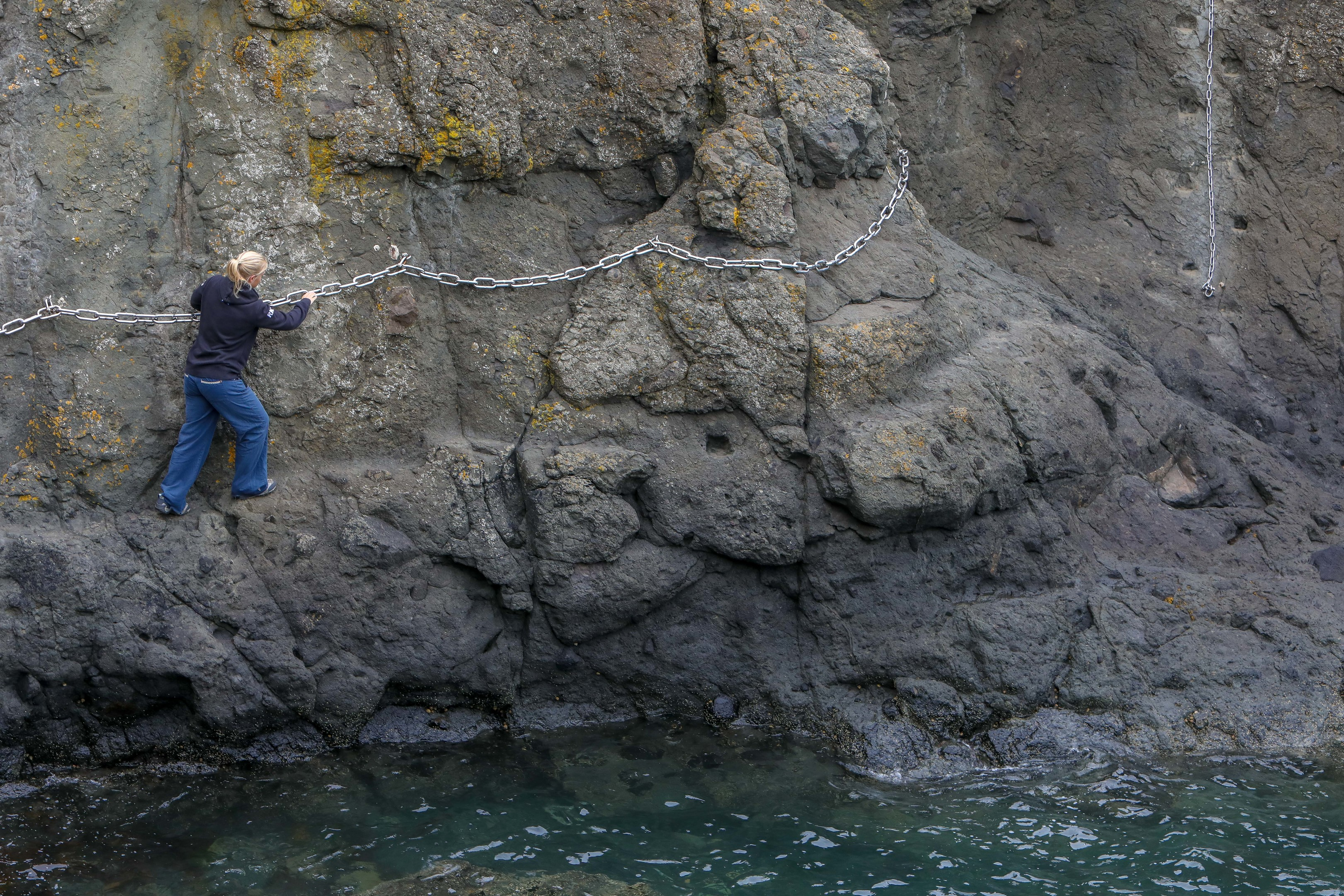 Crew member Becci Jewell navigates a tricky section of the Chain Walk.