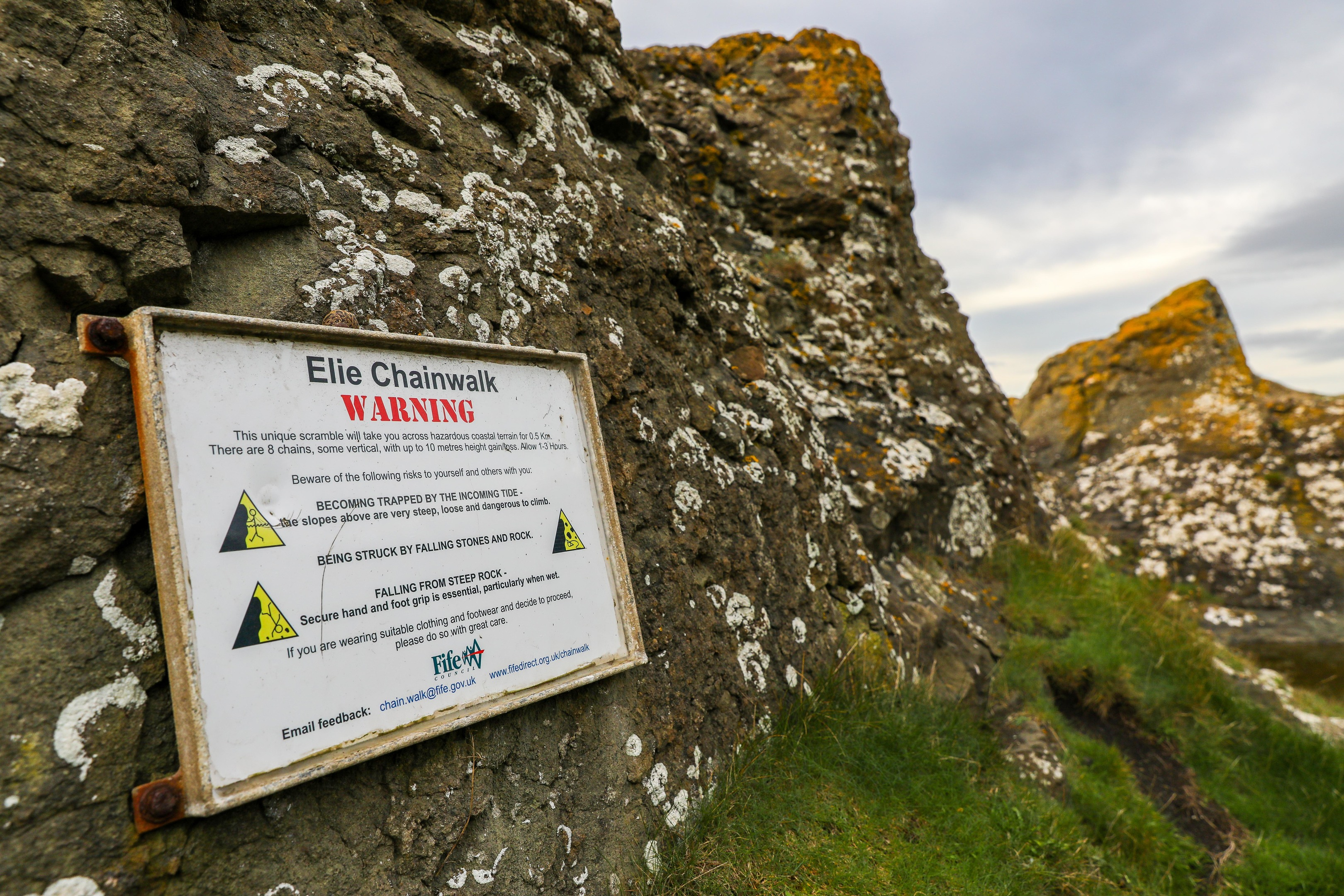 Signage warning of the dangers of the Chain Walk and tides.