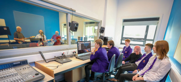 Kinross High pupils recording in their new studio with Sabres performing