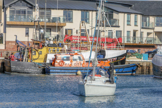 A yacht being returned to Arbroath harbour.
