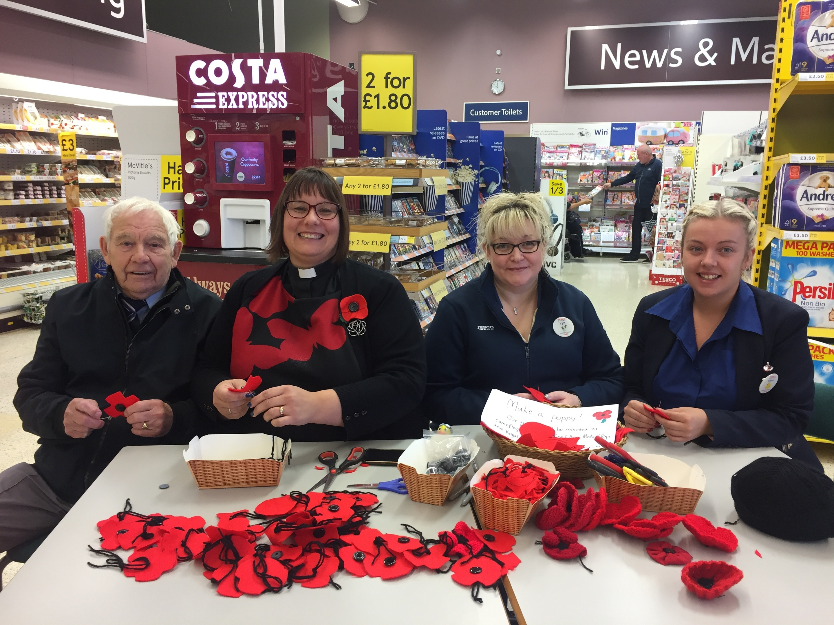 Making poppies at the Forfar Tesco store are, from left, Mike Smith of the Forfar Branch of the Royal Air Forces Association, the Rev Maggie Hunt, Lyn Archer and Kerri Myles.