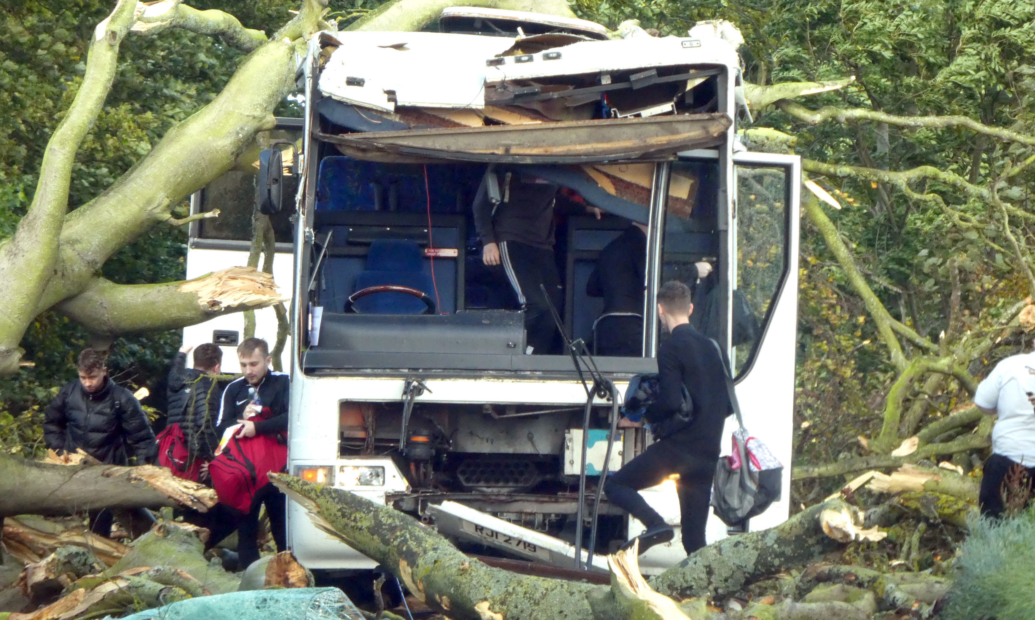 Students from Dundee University exiting a bus after high winds brought by Storm Ali caused a tree to fall onto the vehicle in Kincaple, near Guardbridge in Fife.