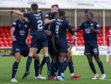 The Dundee players celebrate Kharl Madianga's goal.