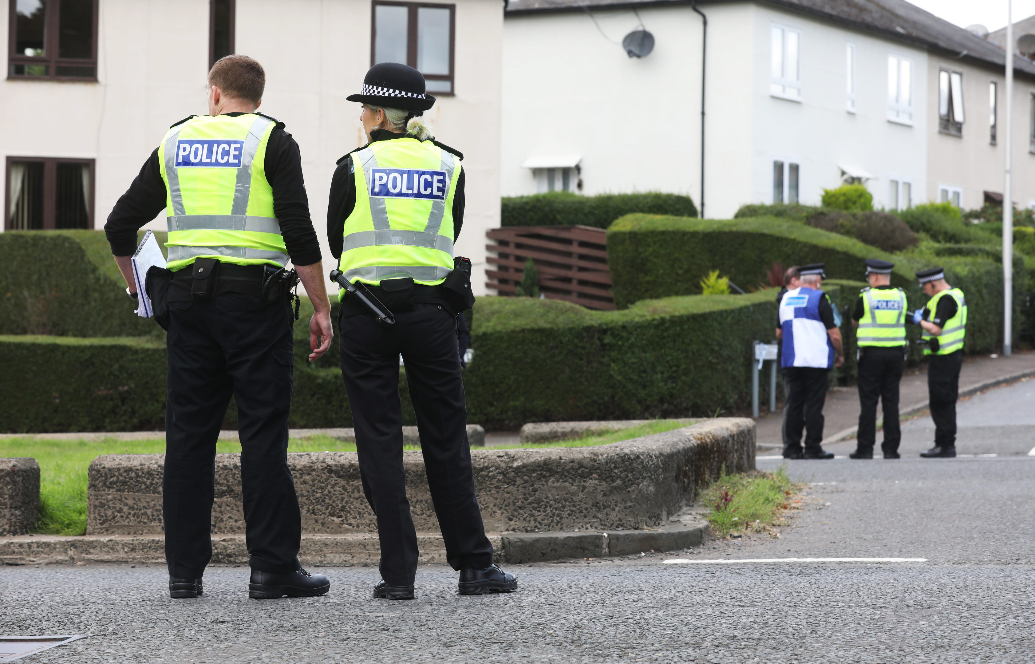 Emergency services at the scene of a bomb scare in Dundee on Carlochie Place.