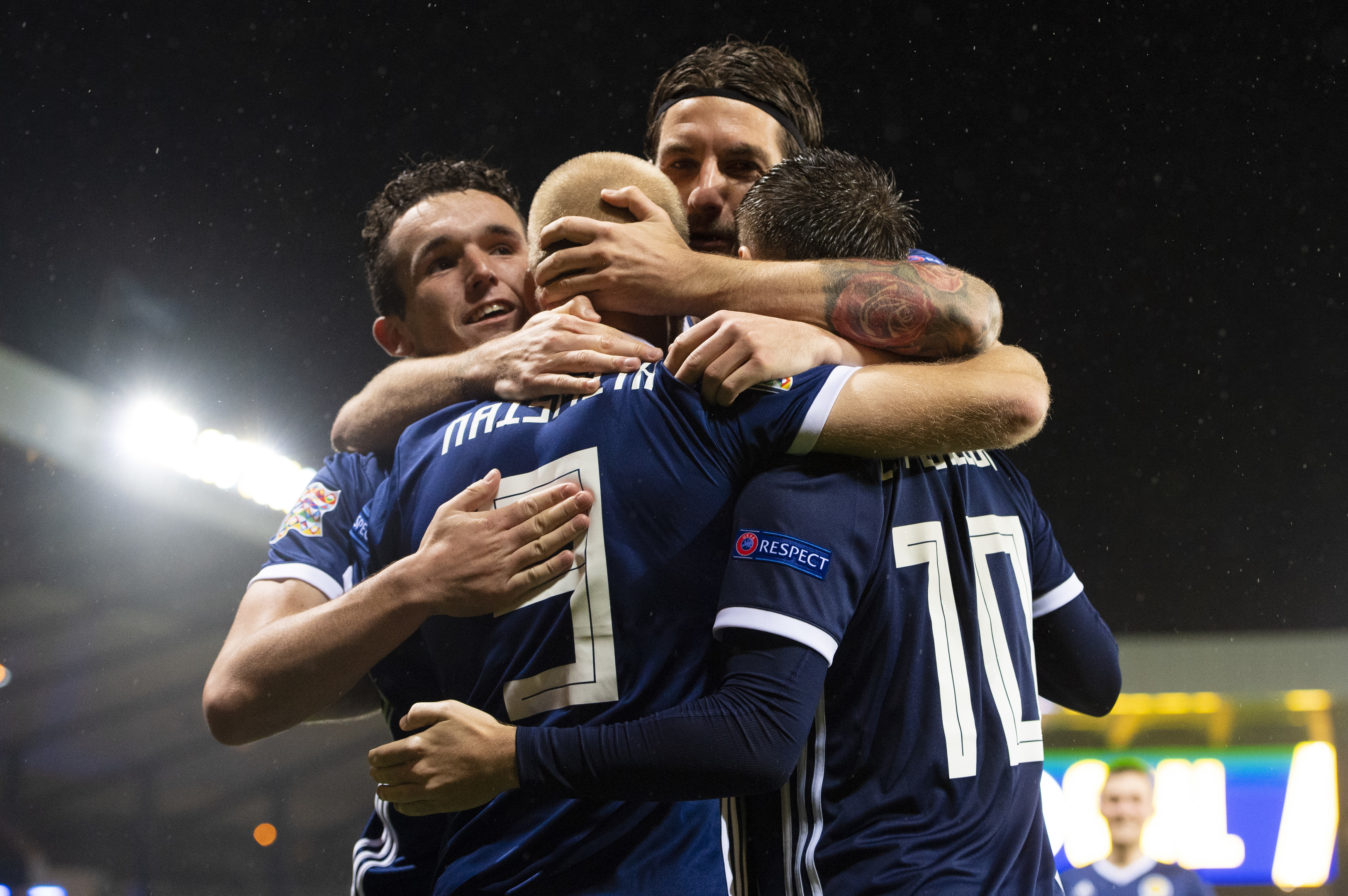 Scotland players celebrate their opening goal.