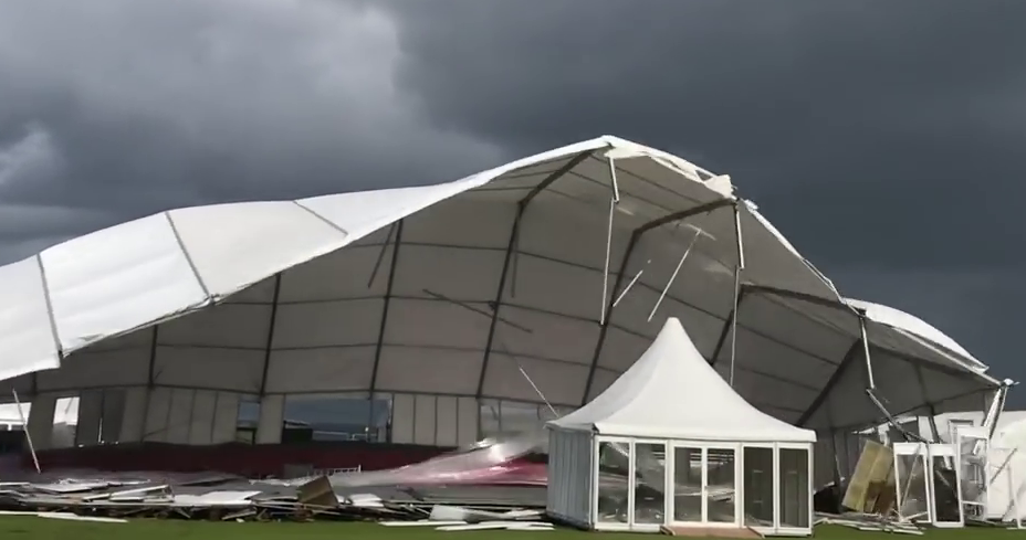 The marquee is ripped open by the wind.