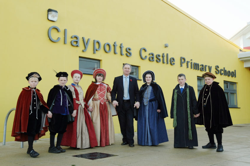 Staff and pupils of Claypotts Primary School in Dundee dressed up in period costumes for the formal opening of the school.