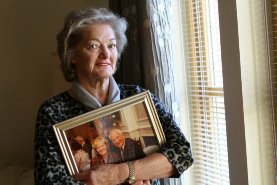 Elizabeth Birrell with a photo of her husband Ian.