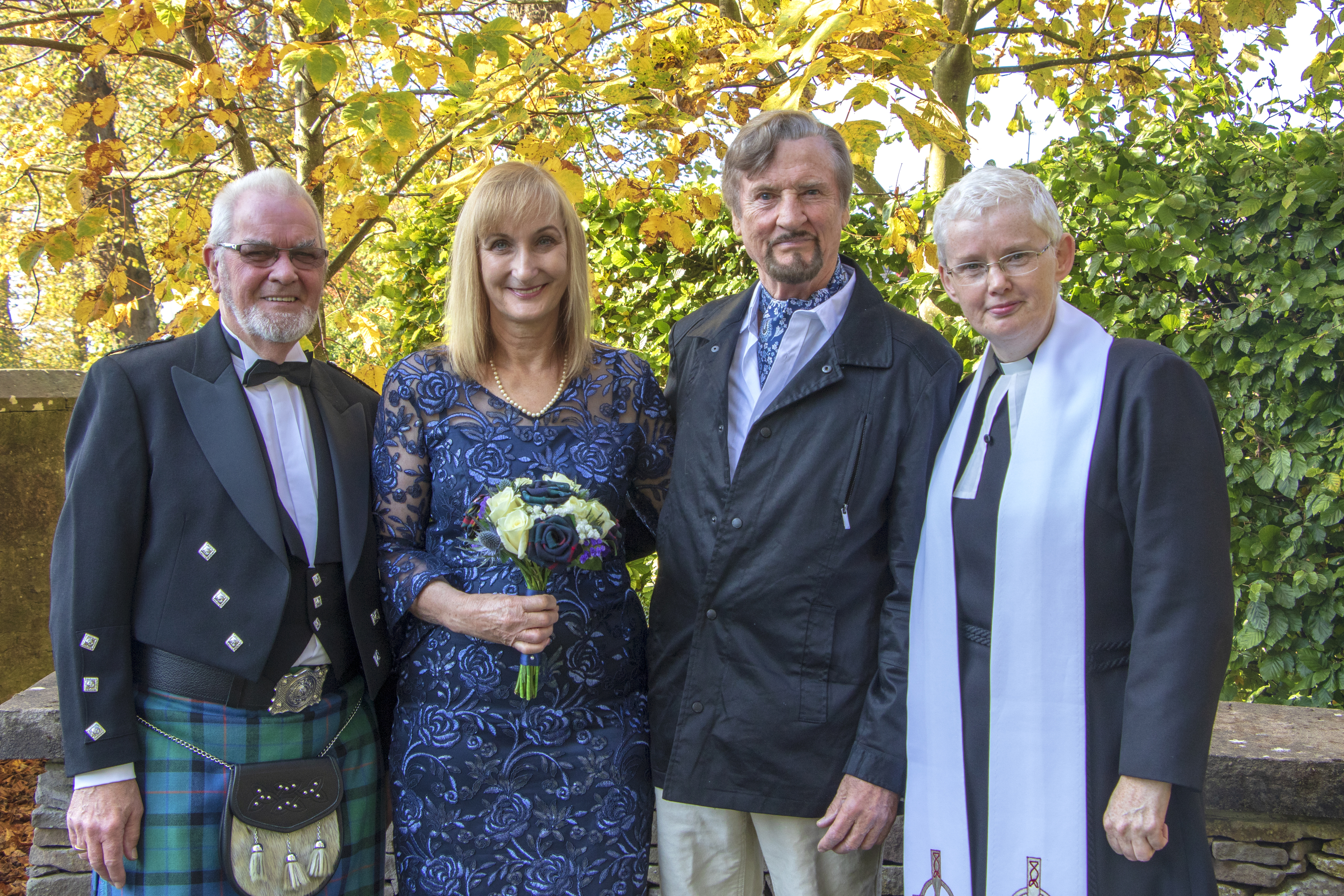 Newlyweds Kate and Paul Wright (centre) with church beadle Ian Lowden and Reverend Marjory MacLean.