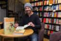 John Buultjens signing copies of his book Ride at Waterstones.