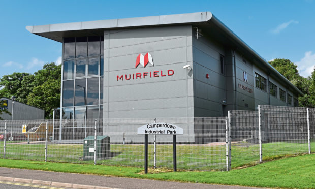 21.07.15 - pictured is the former Muirfield Contracts HQ, George Buckman Drive, Camperdown Industrial Park, Dundee where there is activity emptying some of the contecnts into a skip