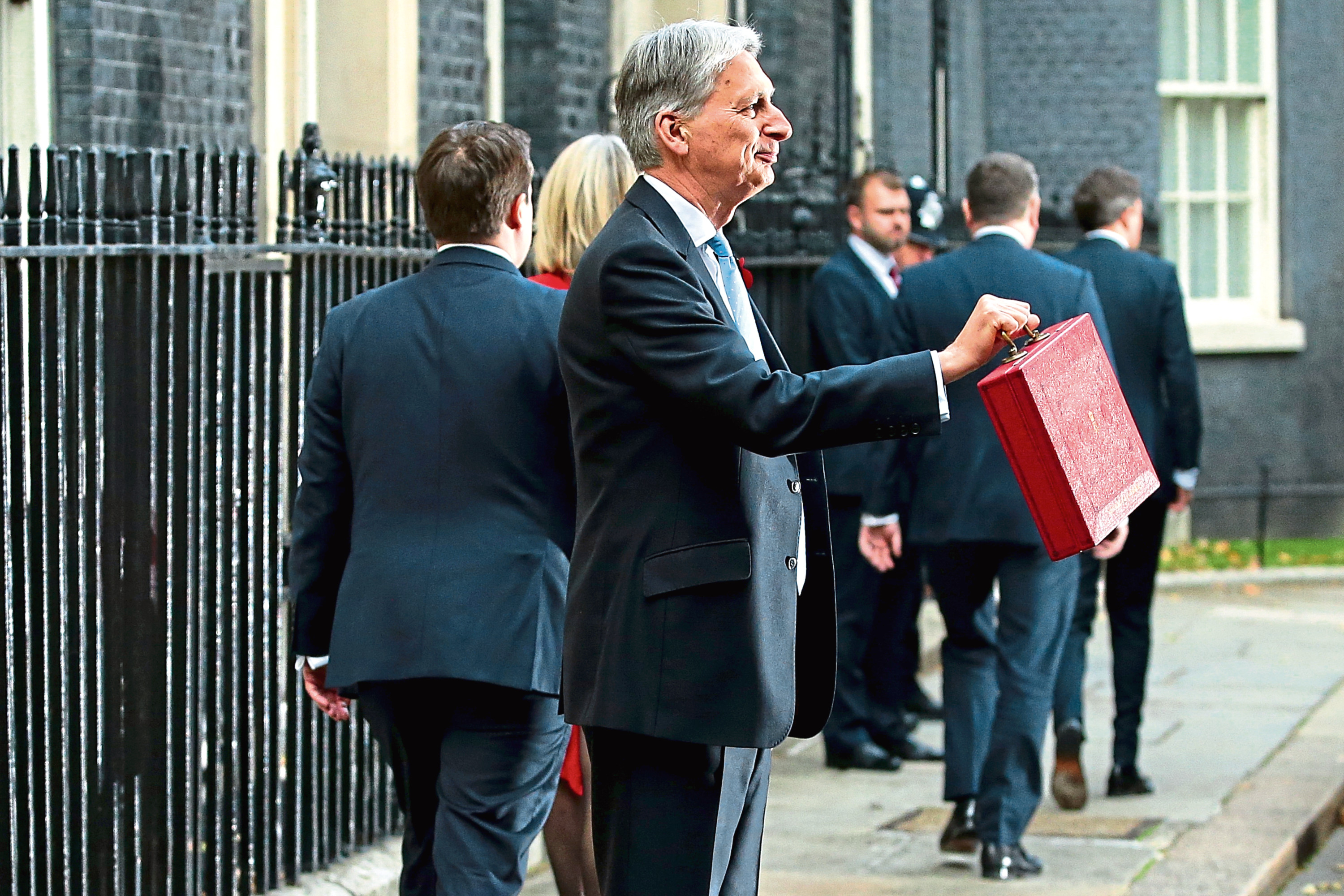 Chancellor of the Exchequer, Philip Hammond, presents the red Budget Box as he departs 11 Downing Street to deliver his 2018 budget announcement to Parliament.