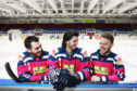 Players Jordan Cownie, Lukas Lundvald and Drydn Dow donning the limited edition pink jerseys ahead of Sunday's game.