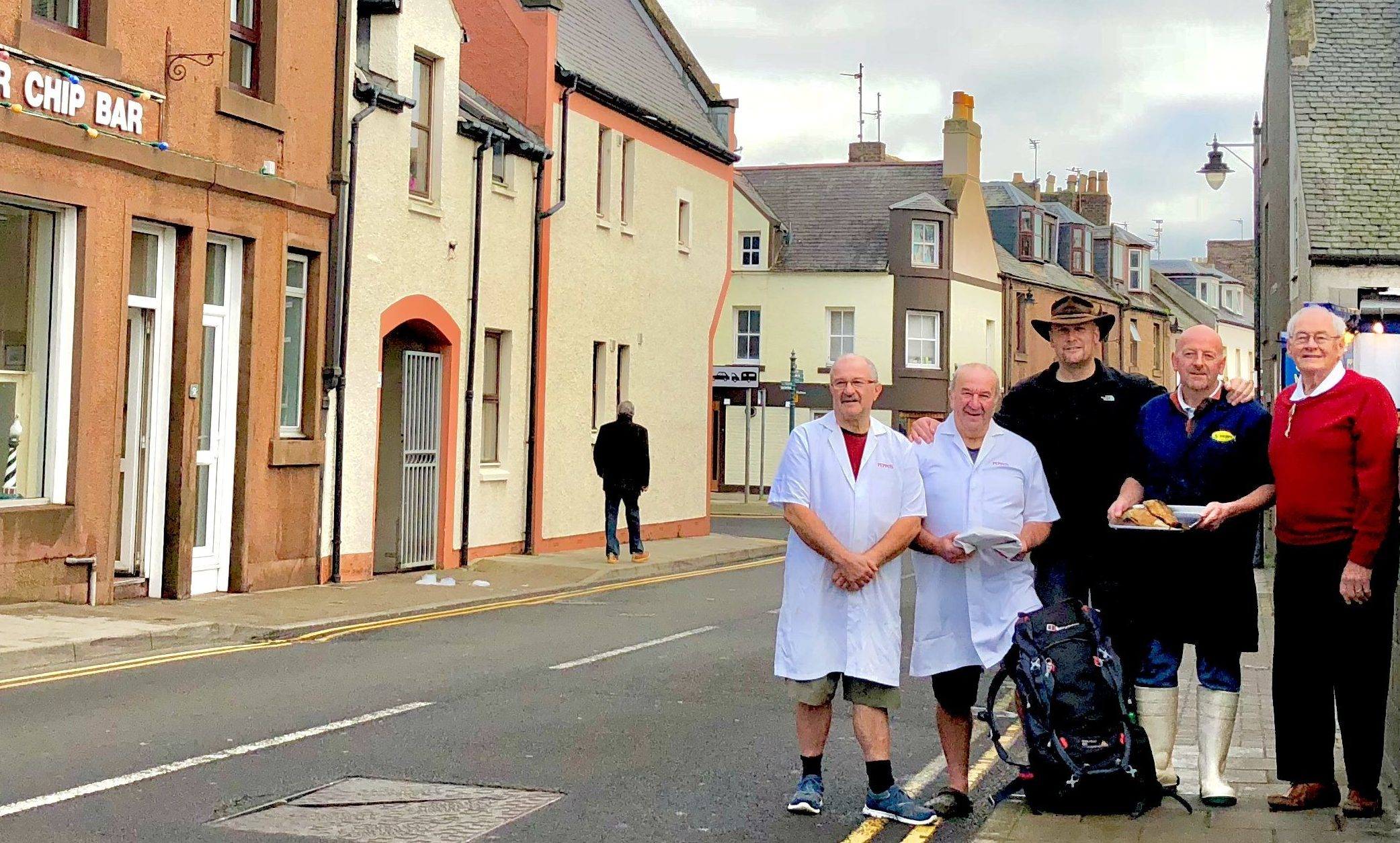 From left, Frank and Johnny Orsi (Peppo's), Caledonian Cowboy, Stuart Scott (Stuart's Fresh Fish) and Mr Rob Johnston (landlord of Osborne Guest House, and scramble egg master).