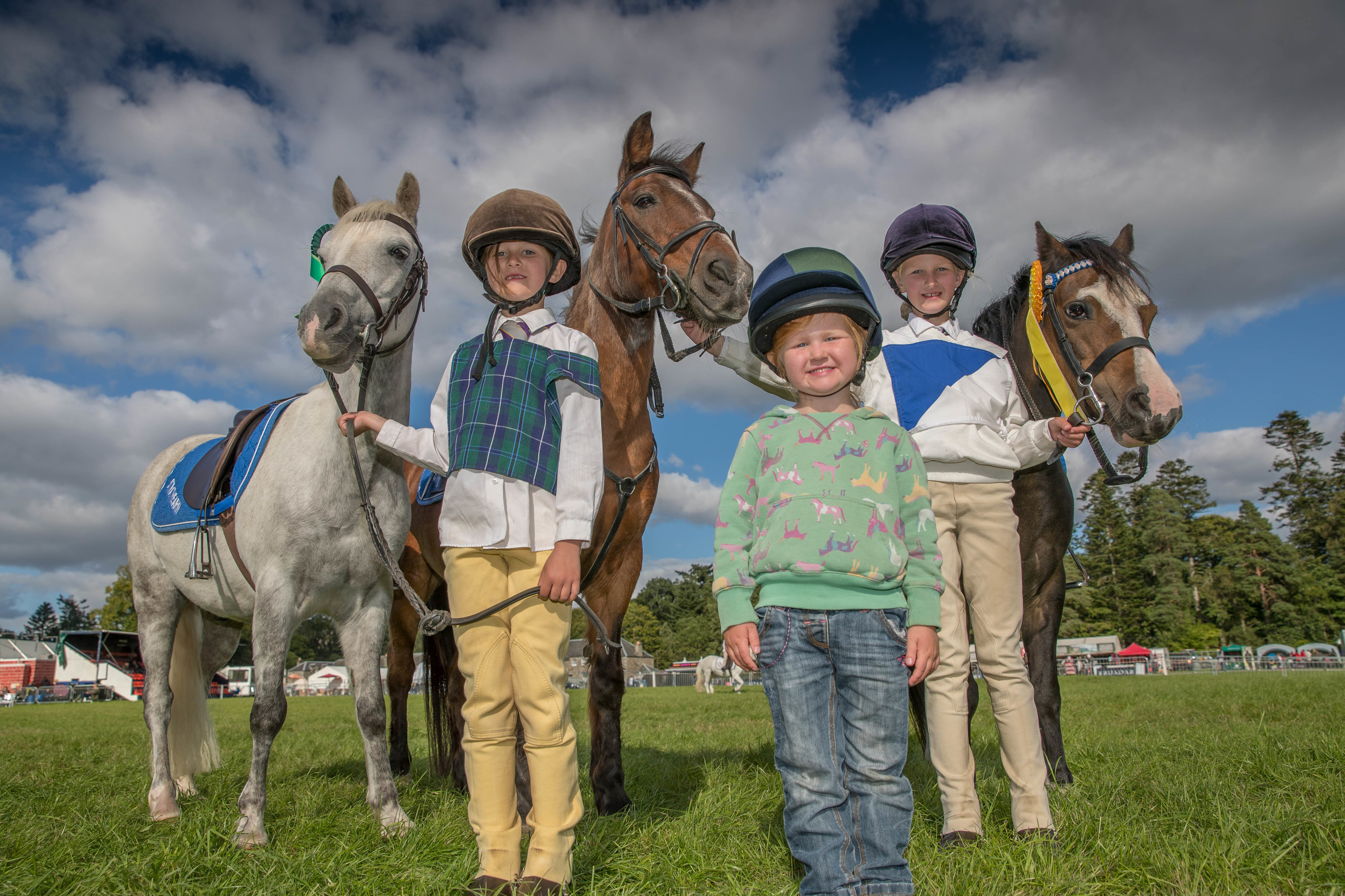Sisters Georgie, Bo and Eilidh Robertson and their ponies Foxy and Hasty at Blair Horse Trials.