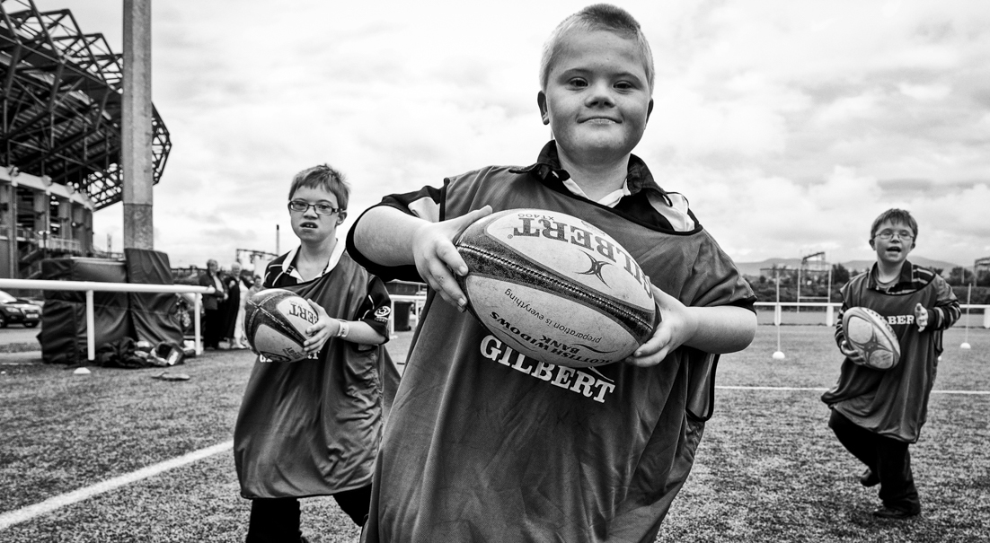 Callum charges me down at a rugby session Murrayfield DS Scotland Calendar. Copyright: Graham Miller