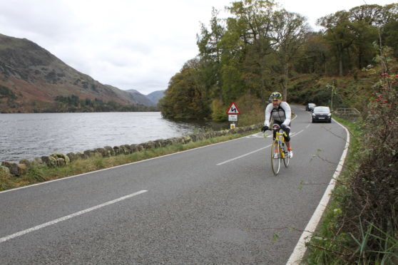 Cyclists often ride further out in the lane to make themselves visible.
