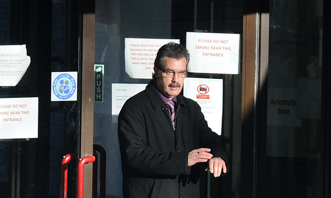 John Morrison leaves Dunfermline Sheriff Court.  (c) David Wardle