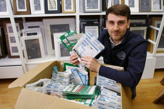 Chris Simpson has dozens of unclaimed photo orders in his Forfar shop