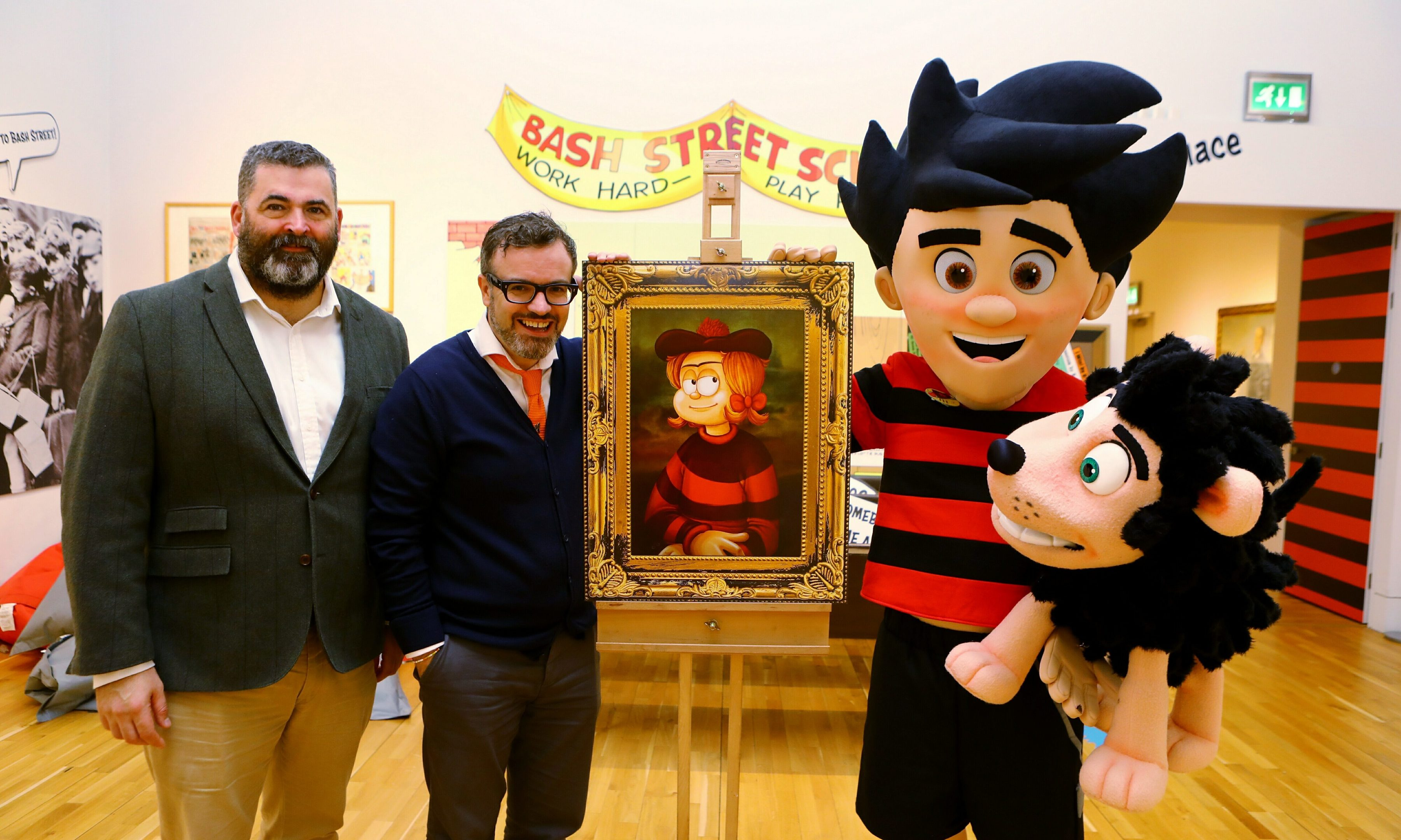 Billy Gartley - head of cultural services at Leisure and Culture DCC, and Mike Stirling - head of Beano Studios, with Dennis and Gnasher.