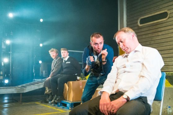 Michael Moreland, Ross Baxter, Ewan Donald and Barrie Hunter in a scene from Dundee Rep's Gagarin Way.