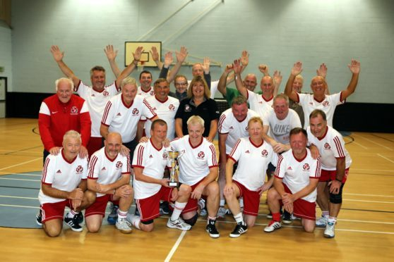 The walking footballers celebrating their success in Portugal.