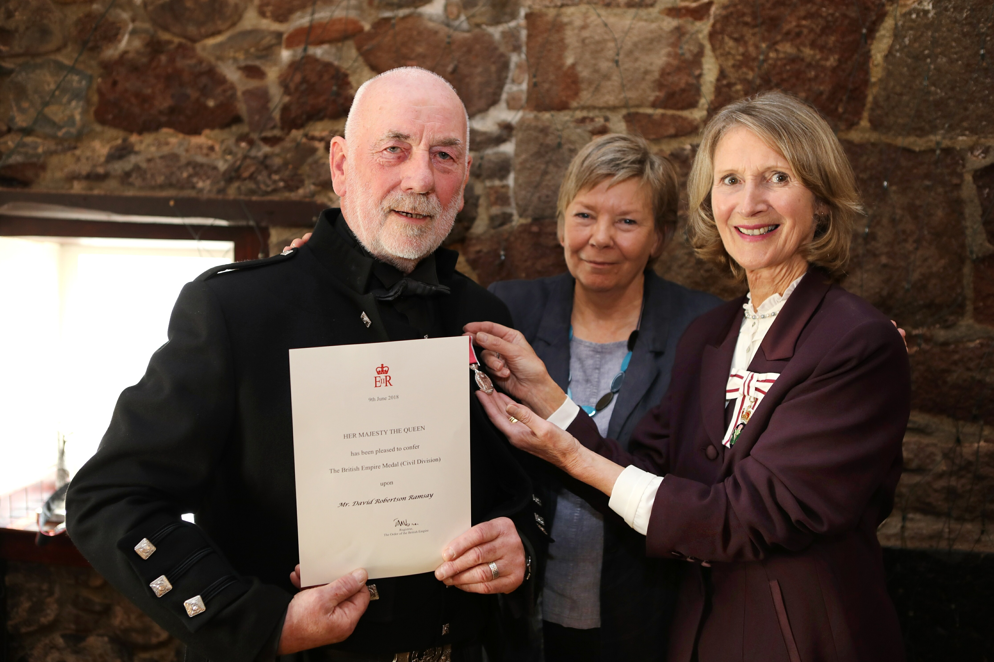 Dave Ramsay, with wife Dorothy, receives his BEM from the Lord Lieutenant of Aberdeenshire Carol Kinghorn.