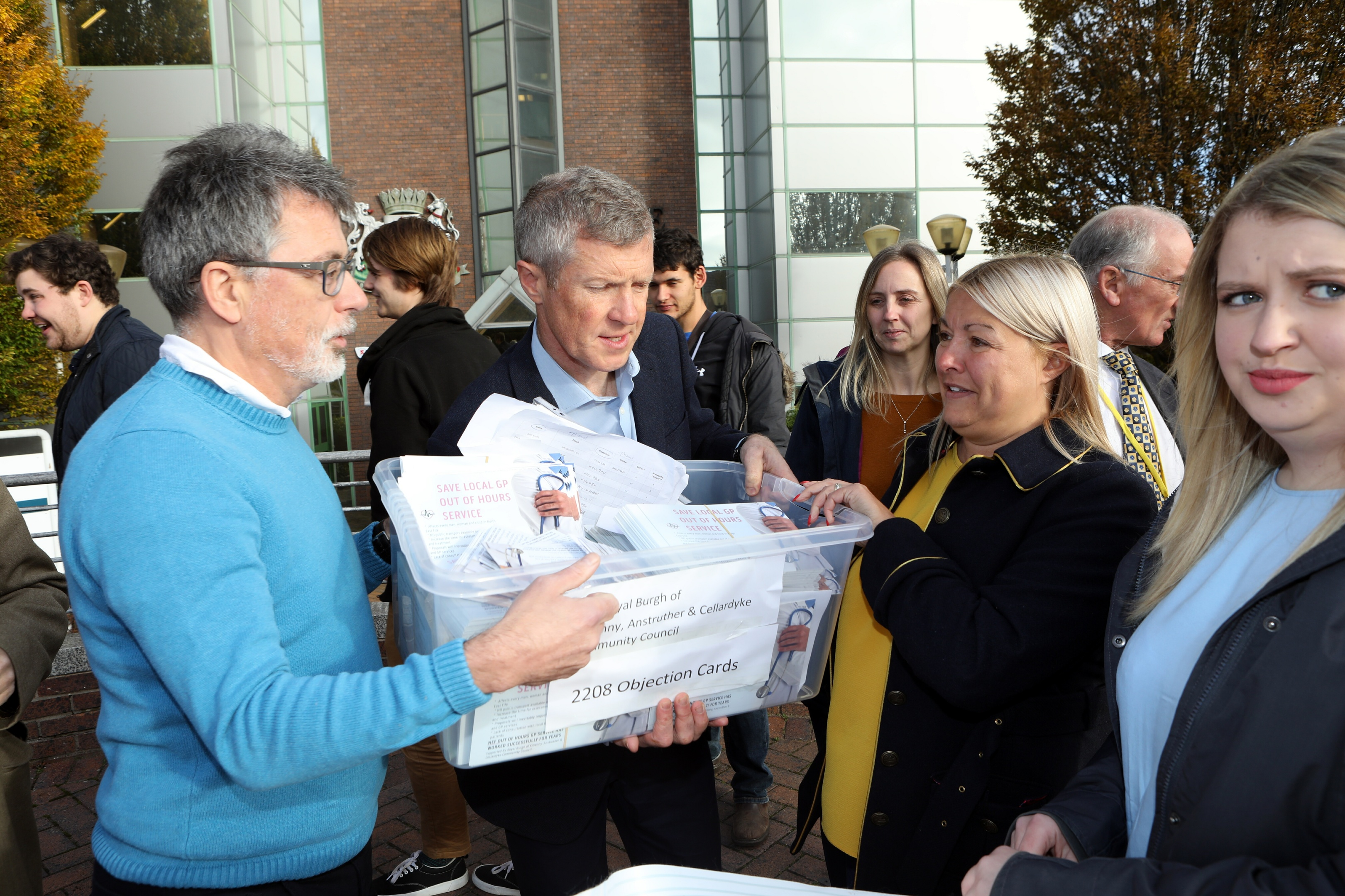 Mr Rennie, centre, and Daryl Wilson of Anstruther Community Council had over the petition to Simon Little