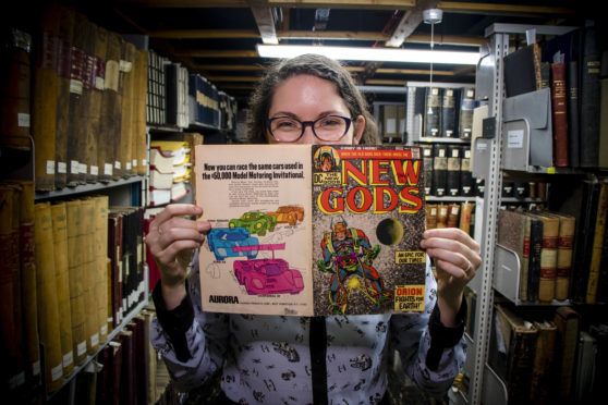 Hailey Austin with a copy of New Gods #1 from 1971.
