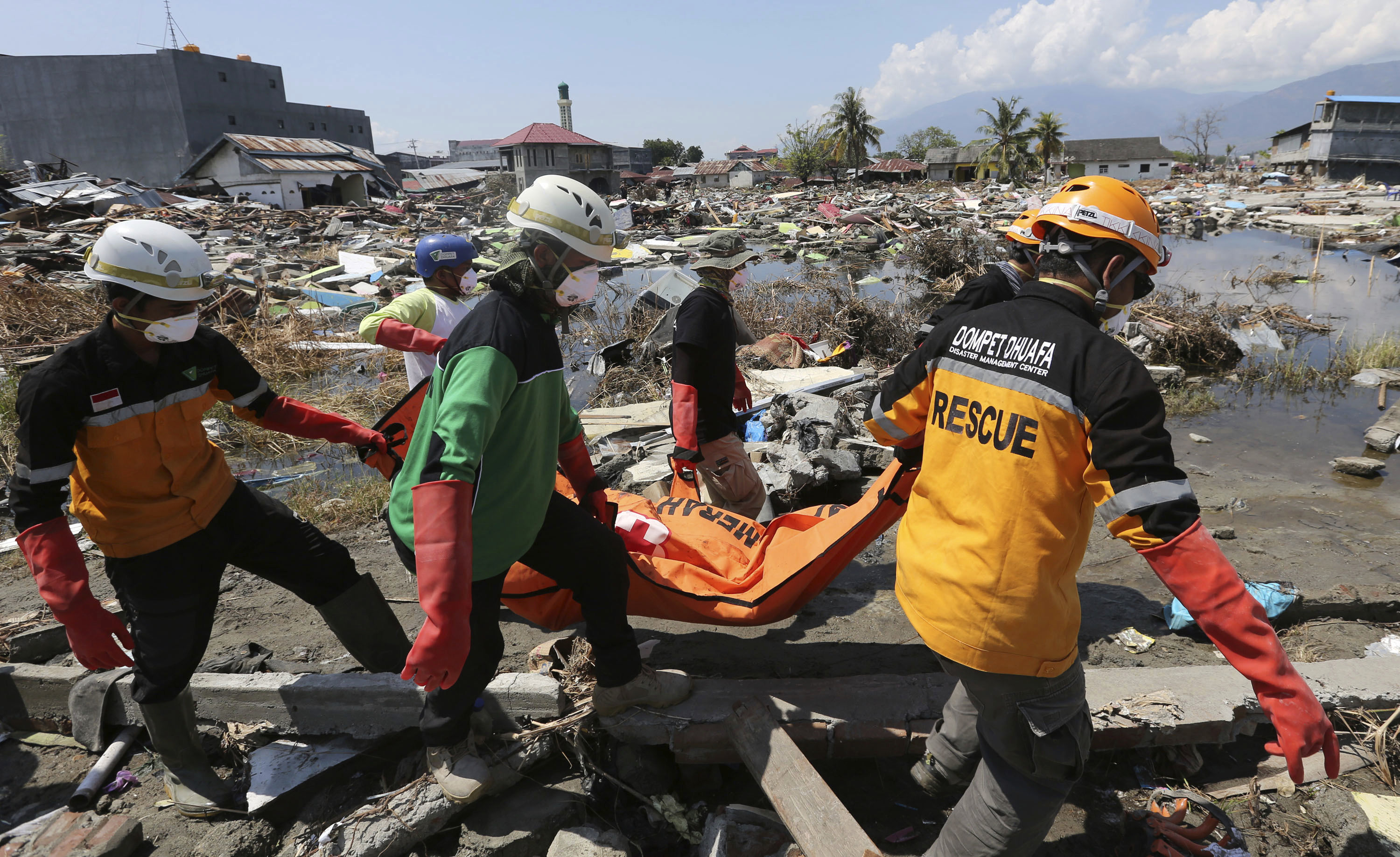 An Indonesian rescue team carries the body of a victim following an earthquake and tsunami in Palu, Central Sulawesi, Indonesia, earlier this month.