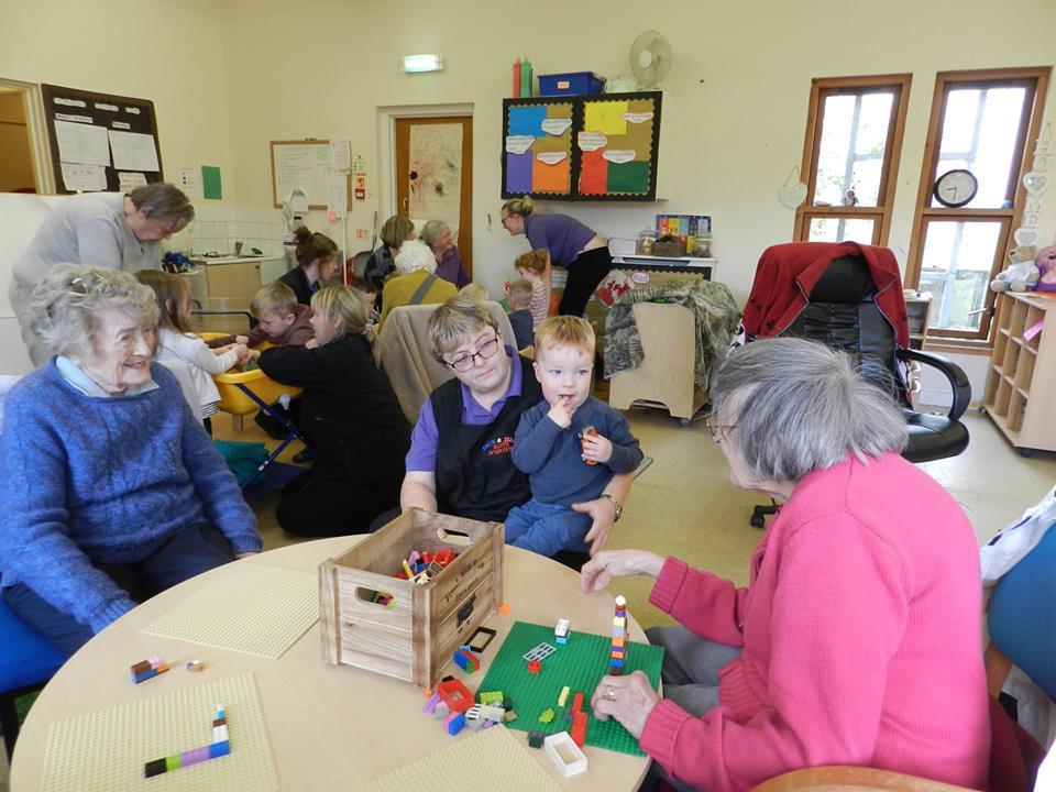 Service users and children at play.
