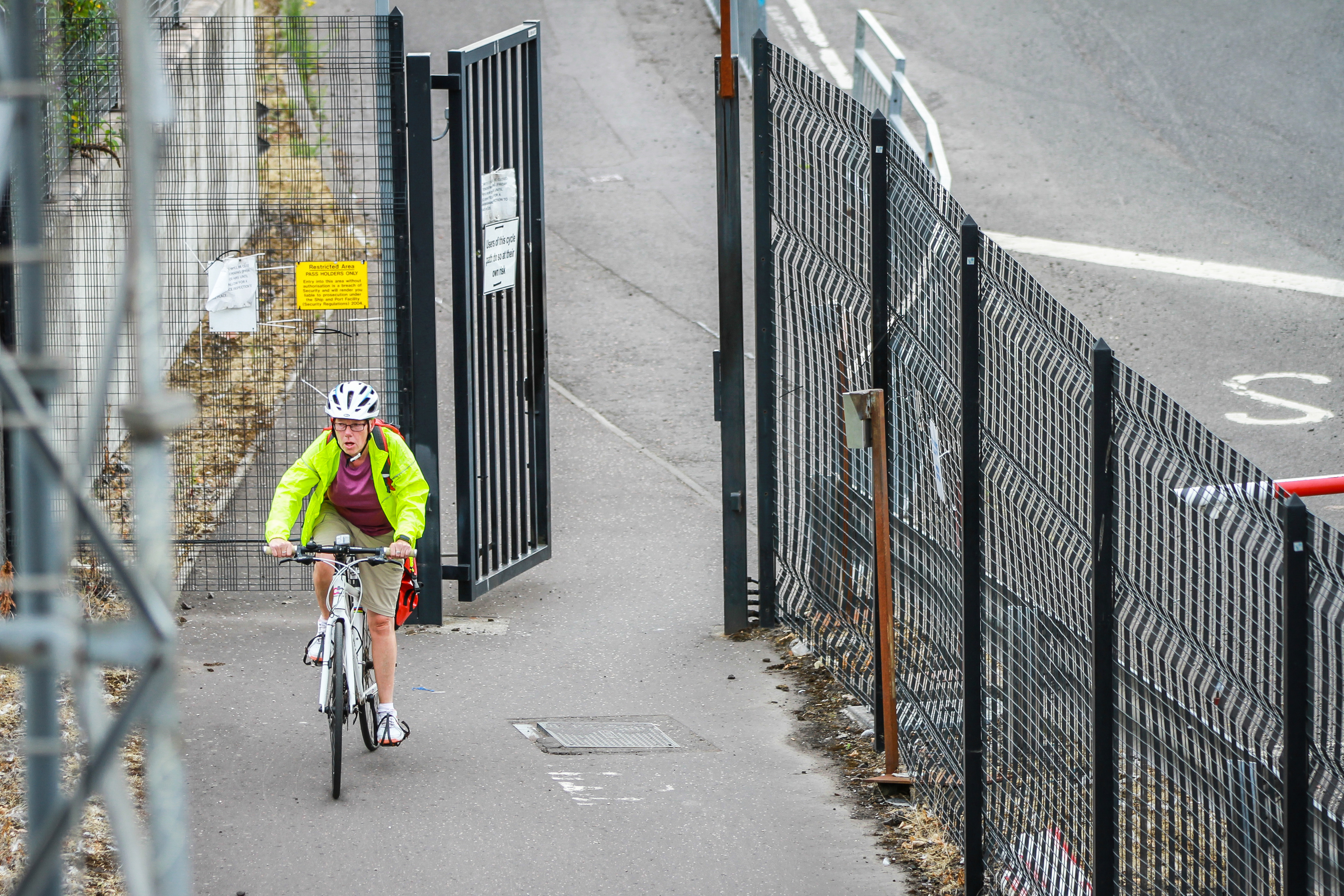 A cyclist entering the Dundee Docks section of the cycle path.