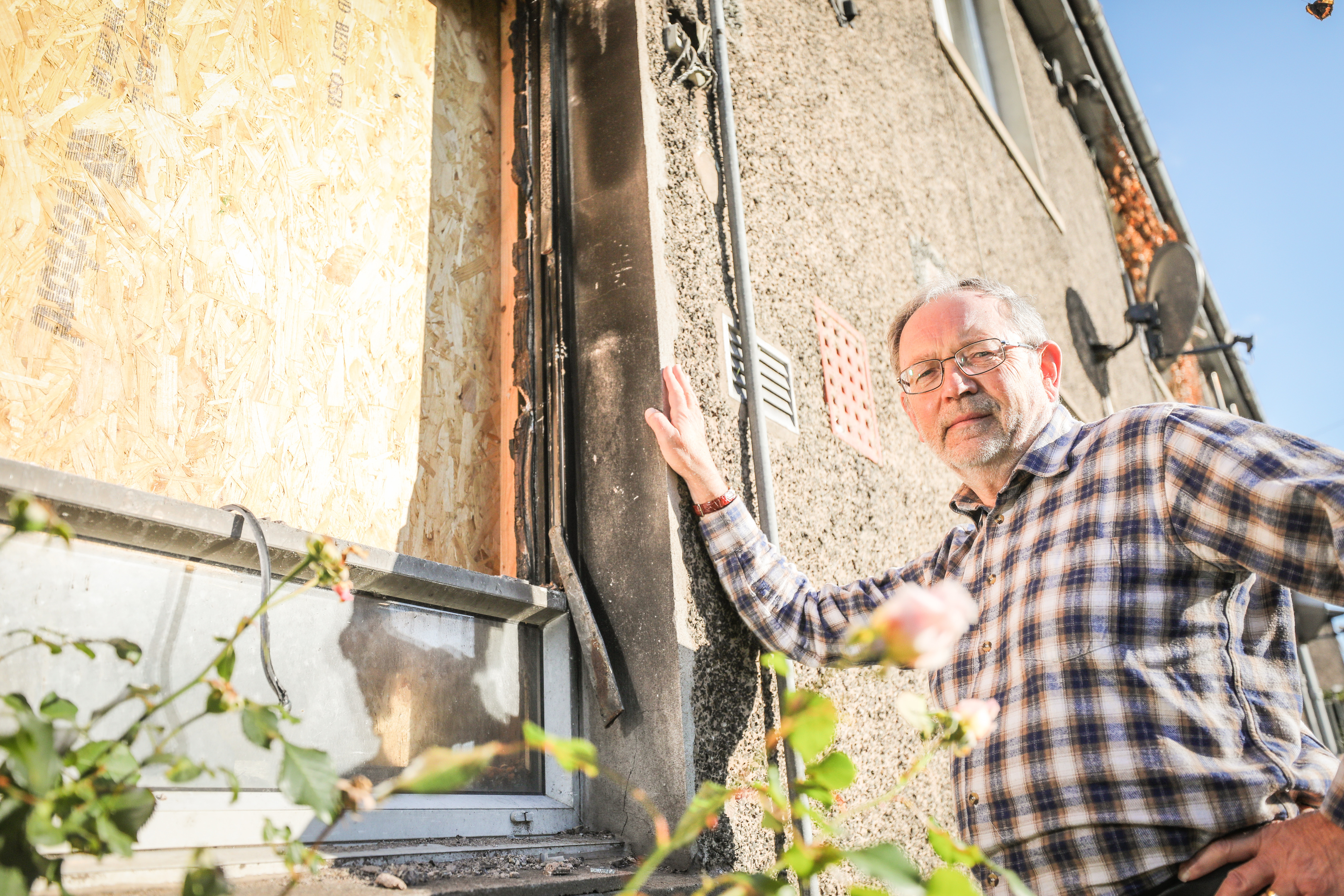Cllr Tim Brett said the delay in repairing the fire-damaged flat was unacceptable